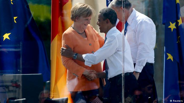 German Chancellor Angela Merkel shakes hands with U.S. President Barack Obama after their speeches next to Berlin Mayor Klaus Wowereit (R) at the Brandenburg Gate in Berlin, June 19, 2013. U.S. President Barack Obama will unveil plans for a sharp reduction in nuclear warheads in a landmark speech at the Brandenburg Gate on Wednesday that comes 50 years after John F. Kennedy declared Ich bin ein Berliner in a defiant Cold War address. REUTERS/Tobias Schwarz (GERMANY - Tags: POLITICS)