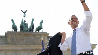 US President Barack Obama waves after giving a speech in front of the Brandenburg Gate in Berlin June 19, 2013. (REUTERS/MichaelKappeler/Pool)