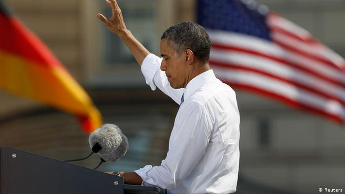 U.S. President Barack Obama gestures as he gives a speech in front of the Brandenburg Gate in Berlin June 19, 2013. Obama's first presidential visit to Berlin comes nearly 50 years to the day after John F. Kennedy landed in a divided Berlin at the height of the Cold War and told encircled westerners in the city Ich bin ein Berliner, a powerful signal that America would stand by them. REUTERS/Wolfgang Rattay (GERMANY - Tags: POLITICS)