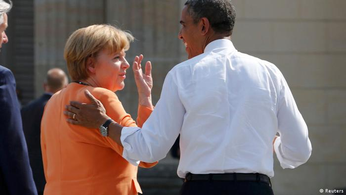 U.S. President Barack Obama chats with German Chancellor Angela Merkel next to Berlin Mayor Klaus Wowereit (L) after their speeches at the Brandenburg Gate in Berlin, June 19, 2013. U.S. President Barack Obama will unveil plans for a sharp reduction in nuclear warheads in a landmark speech at the Brandenburg Gate on Wednesday that comes 50 years after John F. Kennedy declared Ich bin ein Berliner in a defiant Cold War address. REUTERS/Wolfgang Rattay (GERMANY - Tags: POLITICS)