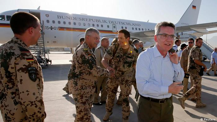 German Defence Minister Thomas de Maiziere (R) arrives in a German Airforce aircraft for his visit to Camp Mamal in the northern city of Mazar-i-Sharif June 20, 2013. (Photo via REUTERS/Fabrizio Bensch)