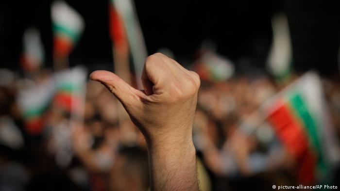 Protester flashes a thumb down during the fourth day of massive protests in Sofia, Bulgaria Monday, June 17, 2013 (Photo: AP Photo/Valentina Petrova)