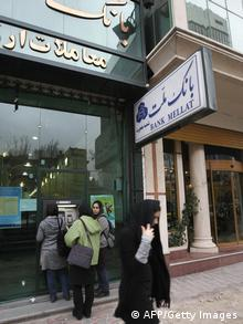 Iranians use a Bank Mellat ATM in downtown Tehran on February 17, 2009. Iran's Bank Mellat unveiled plans to sell a 80 percent stake to private investors despite being under US sanctions, making it the first state-owned bank in the Islamic republic to be privatised. Mellat chairman Ali Divandari told reporters that talks were underway with a number of European and Gulf banks and that the sale will take place over the next two years. AFP PHOTO/BEHROUZ MEHRI (Photo credit should read BEHROUZ MEHRI/AFP/Getty Images)