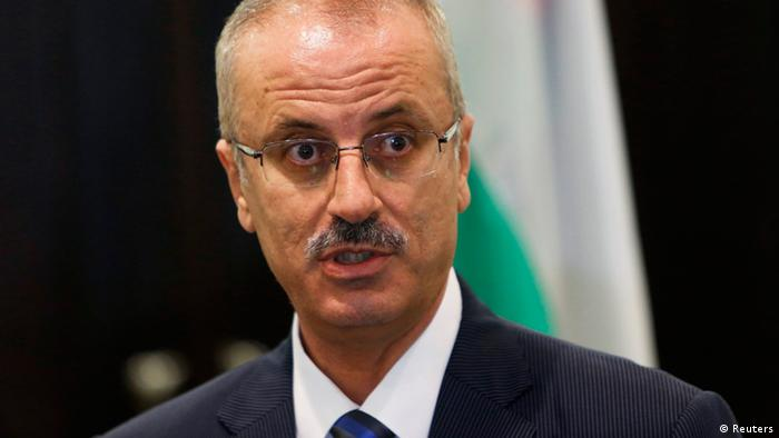 Palestinian Prime Minister Rami Hamdallah speaks during a joint news conference with European Union foreign policy chief Catherine Ashton (not pictured) in the West Bank city of Ramallah June 19, 2013. REUTERS/Mohamad Torokman (WEST BANK - Tags: POLITICS)