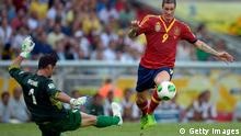 RIO DE JANEIRO, BRAZIL - JUNE 20: Fernando Torres of Spain goes past Mickael Roche of Tahiti on his way to scoring his team's third goal during the FIFA Confederations Cup Brazil 2013 Group B match between Spain and Tahiti at the Maracana Stadium on June 20, 2013 in Rio de Janeiro, Brazil. (Photo by Alexandre Loureiro/Getty Images)