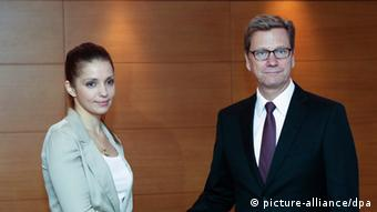 epa03753869 German Foreign Minister Guido Westerwelle (R) meets with Eugenia Tymoshenko, daughter of jailed Ukrainian opposition leader Yulia Tymoshenko , during their meeting in Kiev, Ukraine, 21 June 2013. Guido Westerwelle arrived in Ukraine for one-day working visit. EPA/SERGEY DOLZHENKO pixel