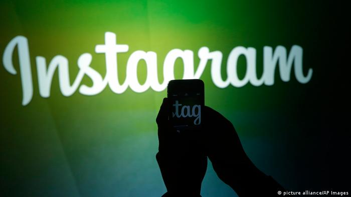 A journalist makes a video of the Instagram logo using the new video feature at Facebook headquarters in Menlo Park, Calif., Thursday, June 20, 2013. (AP Photo/Marcio Jose Sanchez)