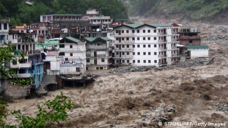 Fast moving water from the Alaknanda river destroys building during a heavy monsoon rain in Govindghat town in the Indian state of Uttrakhand on June 17, 2013. Heavy rains lashed parts of north India Monday, resulting in the deaths of at least 18 people, as the annual monsoon covered the country nearly two weeks ahead of schedule, officials said. (Photo: AFP)