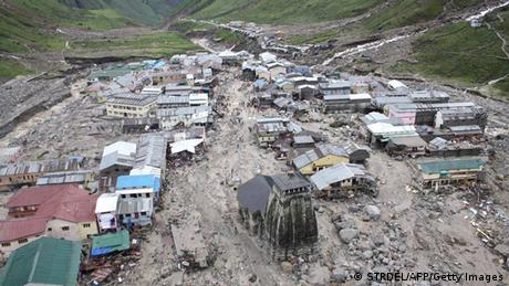 The Kedarnath Temple (C, foreground) is pictured amid flood destruction in the holy Hindu town of Kedarnath, located in Rudraprayag district in the northern Indian state of Uttarakhand, on June 18, 2013. (Photo: AFP)