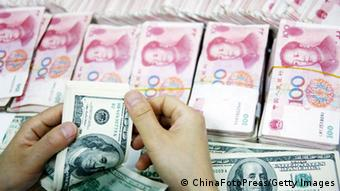 HUAIBEI, CHINA - JULY 26: (CHINA OUT) An employee counts money at a branch of Industrial and Commercial Bank of China Limited (ICBC) on July 26, 2011 in Huaibei, Anhui Province of China. According to the China Foreign Exchange Trading System, The Chinese currency, Renminbi (RMB), Tuesday rose 33 basis points from previous trading day to a record high of 6.4470 against the U.S. dollar. (Photo by ChinaFotoPress/Getty Images)
