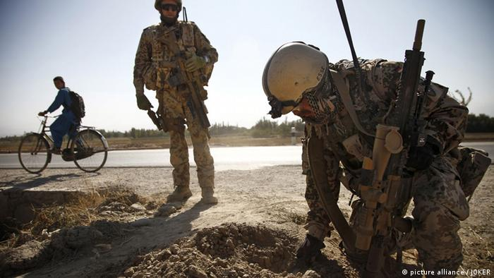 German army soldier searching for mines in Kunduz, Afghanistan, 21.10.2012