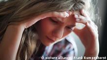 Jugendliche mit Kopfschmerzen