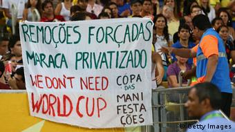 RIO DE JANEIRO, BRAZIL - JUNE 20: Protestors display banners during the FIFA Confederations Cup Brazil 2013 Group B match between Spain and Tahiti at the Maracana Stadium on June 20, 2013 in Rio de Janeiro, Brazil. (Photo by Ronald Martinez/Getty Images)