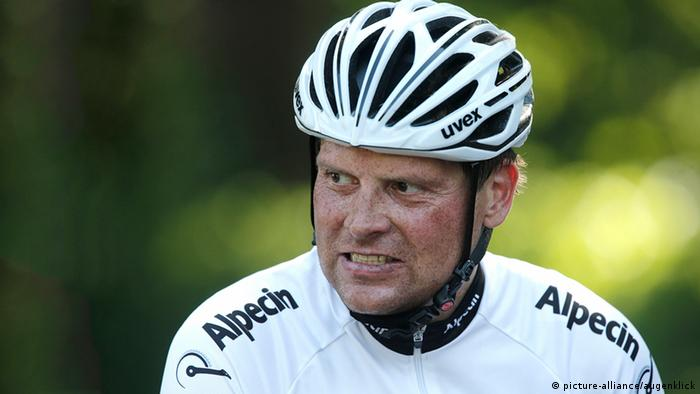 Picture of German former professional cyclist Jan Ullrich, wearing a helmet.