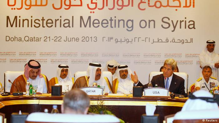 U.S. Secretary of State John Kerry (R) speaks during the London 11 countries Friends of Syria meeting in Doha June 22, 2013. Western and Arab opponents of Bashar al-Assad met in Qatar on Saturday to tighten coordination of their stepped up support for rebels battling to overthrow the Syrian president. REUTERS/Mohammed Dabbous (QATAR - Tags: POLITICS CONFLICT)