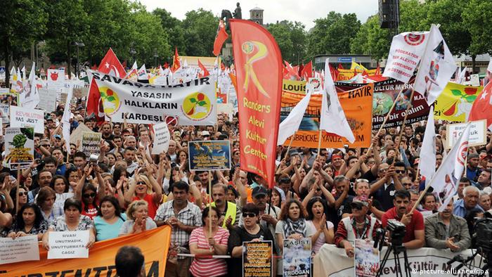 Protesters in Cologne, taking part in a march organized by the Alevi Community in Germany (Alewitische Gemeinde Deutschland). (Photo via Henning Kaiser/dpa)