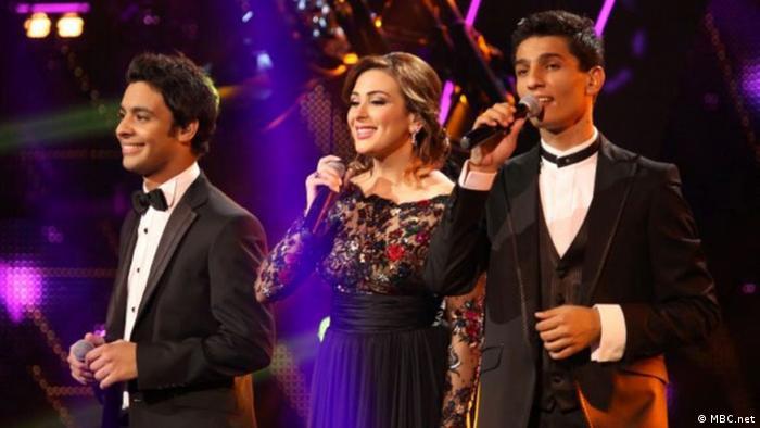 ***ACHTUNG: Bild nur zur Berichterstattung über Arab Idol verwenden!!!*** Auf dem Bild: Die Finalisten von Arab Idol 2013. Ahmad, Farah und Assaff. Quelle: http://www.mbc.net/ar/programs/arab-idol-s2/photos/live-performance/finals/articles/%D8%B5%D9%88%D8%B1---%D8%A3%D8%AC%D9%88%D8%A7%D8%A1-%D8%A7%D9%84%D8%AC%D9%85%D8%B9%D8%A9-%D8%A7%D9%84%D8%A3%D8%AE%D9%8A%D8%B1%D8%A9-%D9%81%D9%8A-Arab-Idol-%D9%88%D8%A3%D8%AF%D8%A7%D8%A1-%D9%85%D9%85%D9%8A%D8%B2-%D9%84%D9%84%D9%85%D8%B4%D8%AA%D8%B1%D9%83%D9%8A%D9%86.html#19 Rechte: MBC.net
