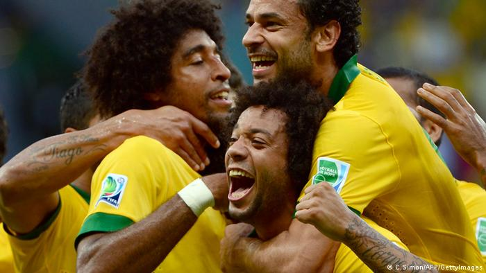 Brazil's defender Dante (L) celebrates with teammates Marcelo (C) and Fred after scoring against Italy during their FIFA Confederations Cup Brazil 2013 Group A football match, at the Fonte Nova Arena in Salvador, on June 22, 2013. AFP PHOTO / CHRISTOPHE SIMON (Photo credit should read CHRISTOPHE SIMON/AFP/Getty Images)