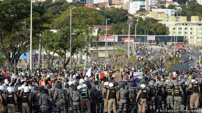 Riot policemen guard demonstrators during a protest against corruption and price hikes in Belo Horizonte, Brazil on June 22, 2013.