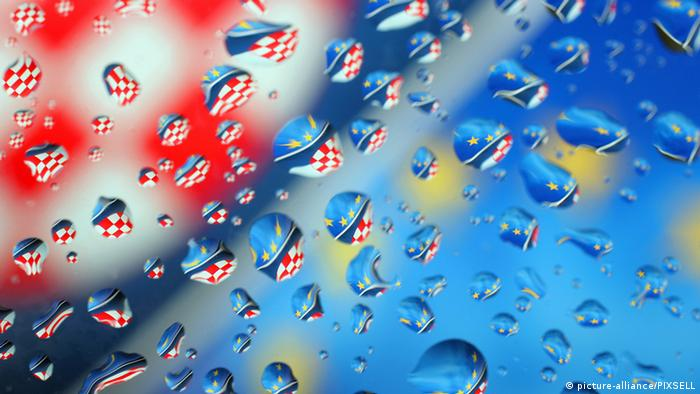 04.10.2005., Croatia, Zagreb - Flags of the European Union and the Republic of Croatia reflected in raindrops on a window. Photo: Zeljko Lukunic/PIXSELL