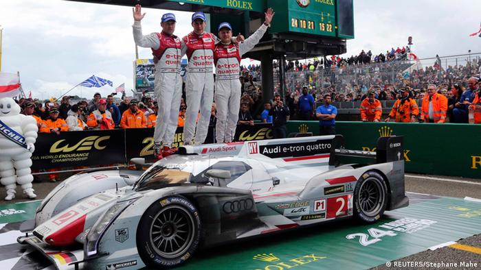 Audi R18 E-Tron Quattro Number 2 drivers celebrate after winning the Le Mans 24-hour sportscar race in 2013