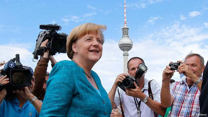German Chancellor and leader of the Christian Democratic Union (CDU) Angela Merkel (C) arrives for a party meeting with the Christian Social Union (CSU) in Berlin June 23, 2013. The building in the background is the television tower. REUTERS/Tobias Schwarz (GERMANY - Tags: POLITICS)