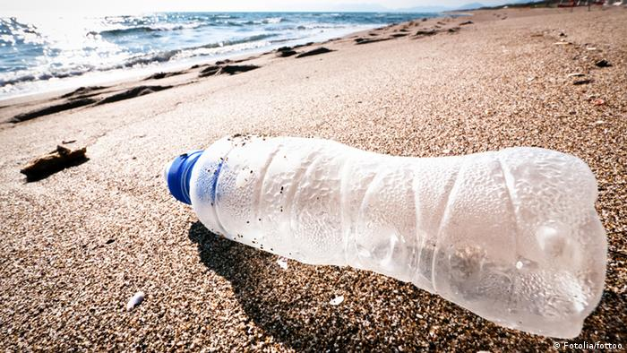 An empty plastic bottle on a beach