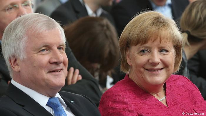 Bavarian Christian Social Union (CSU) Chairman Horst Seehofer and Chancellor and German Christian Democratic Union (CDU) Chairwoman Angela Merkel attend a summit of the two parties to present their election policy program on June 24, 2013 in Berlin, Germany. (Photo by Sean Gallup/Getty Images)