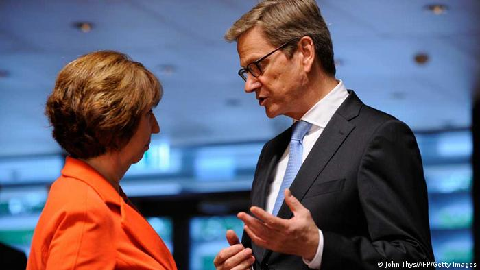 High Representative of the European Union for Foreign Affairs and Security Policy Baroness, Catherine Ashton (L) speaks with German Foreign minister Guido Westerwelle before a Foreign Affairs Council meeting on June 24, 2013 at the Kirchberg conference center in Luxembourg. AFP PHOTO /JOHN THYS (Photo credit should read JOHN THYS/AFP/Getty Images)