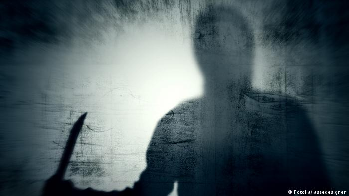 Shadow of a man with a knife