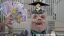 A protester in a pig costume holds fake peso bills during a demonstration in front of the Mexican Electoral Tribunal building while a plenary takes place inside in Mexico City on August 30, 2012. Mexico's electoral court prepared Thursday to rule on a left-wing bid to overturn the presidential election win of Enrique Pena Nieto, as metal fences were placed around the tribunal to keep protesters out. AFP PHOTO/ YURI CORTEZ (Photo credit should read YURI CORTEZ/AFP/GettyImages)