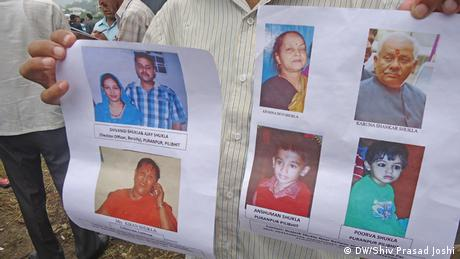 Posters bearing the faces of people missing after the flash floods in northern India. (Photo: DW/Shiv Prasad Joshi)