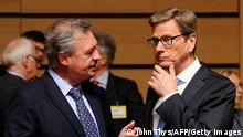 Luxemburg's Foreign minister Jean Asselborn (L) speaks with German Foreign minister Guido Westerwelle before a Foreign Affairs Council meeting on June 24, 2013 at the Kirchberg conference center in Luxembourg. AFP PHOTO /JOHN THYS (Photo credit should read JOHN THYS/AFP/Getty Images)