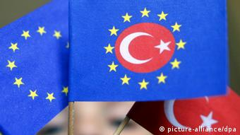 Stars of the EU flag surrounding the red star and crescent of the Turkish flag. Photo: Frank Rumpenhorst dpa Pixel