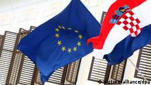 Croatian and the EU flag are seen on Croatia's government building at the St. Mark square in Zagreb, Croatia, 24 June 2011. The EU Council gave the green light in Bruxelles for Croatia to finish negotiation with the EU and join the union, with membership likely to start first on July 2013. Croatia celebrates the 20 years of independence after it part ways with former Yugoslavia. EPA/ANTONIO BAT