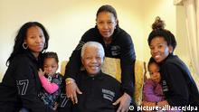 epa03120896 (FILE) A file photo handed out on 17 July 2011 by the Nelson Mandela Foundation shows former South African African President Nelson Mandela (C, seated) preparing to celebrate his 93rd birthday with his extended family at his home in Qunu, South Africa, 17 July 2011. With him are (L to R) Zaziwe Manaway and baby Ziphokazi Manaway, daughter Princess Zenani Mandela, Zamaswazi Dlamini and baby Zamakhosi Obiri. Former South African president Nelson Mandela has been admitted to hospital after suffering from abdominal pains, the SAPA news agency reported on 25 February 2012. Mandela, who is 93, has been in ill health for some time. EPA/PETER MOREY/NELSON MANDELA FOUNDATION/HANDOUT HANDOUT EDITORIAL USE ONLY/NO SALES *** Local Caption *** 00000402828579