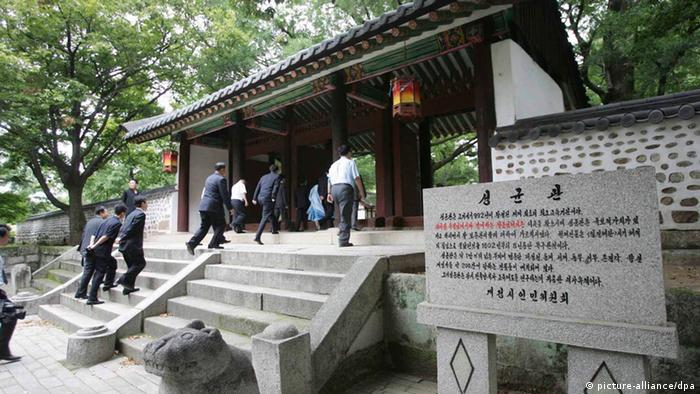 In this undated photo, visitors go up the stairs at Koryo Songgyungwan in Kaesong, North Korea. (Photo: dpa)