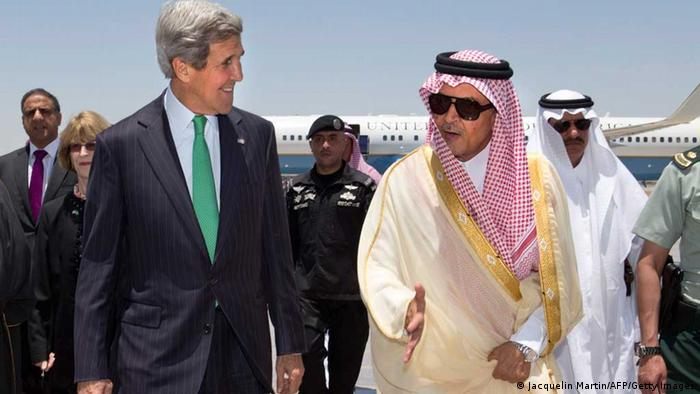 US Secretary of State John Kerry (L) is greeted by Saudi Foreign Minister Prince Saud al-Faisal (R) upon his arrival in Jeddah, on June 25, 2013. Kerry arrived in Saudi Arabia in hopes of coordinating support for Syria's rebels amid fears that a prolonged civil war will embolden extremists. AFP PHOTO/JACQUELYN MARTIN/POOL (Photo credit should read JACQUELYN MARTIN/AFP/Getty Images)
