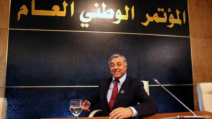 epa03759674 The newly-elected chairman of the Libyan General National Congress, Nuri Abu-Sahmain, poses for a photo under a banner reading in Arabic _General National Congress_, in Tripoli, Libya, 25 June 2013. Abu-Sahmain was elected after a second round of voting in which he got 96 votes while his contender Sharif Al-Wafi Mohamed got 80. The former head of Libya's parliament, Mohammed al-Magariaf, resigned on 28 May 2013 because he falls under a recently adopted Political Isolation Law barring officials who served under slain leader Muammar Gaddafi from holding office. EPA/SABRI ELMHEDWI +++(c) dpa - Bildfunk+++