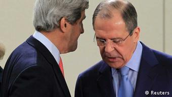 U.S. Secretary of State John Kerry (L) talks with Russian Foreign Minister Sergei Lavrov at the start of a NATO - Russia foreign ministers meeting at the Alliance's headquarters in Brussels April 23, 2013. REUTERS/Yves Herman (BELGIUM - Tags: POLITICS)