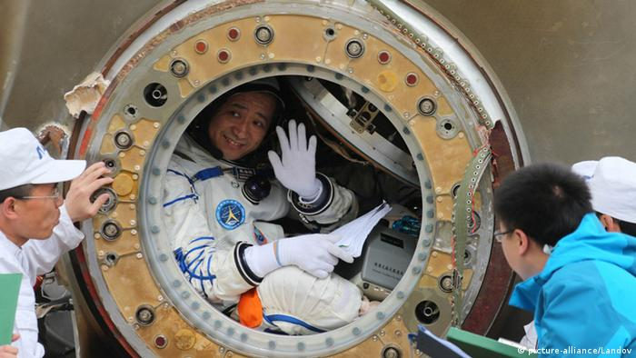 Chinese astronaut waving
