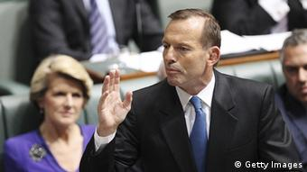 CANBERRA, AUSTRALIA - JUNE 26: Opposition leader Tony Abbott gestures during question time at Parliament House on June 26, 2013 in Canberra, Australia. It has been reported Rudd supporters are circulating a petition for a special caucus meeting for a ballot on the Labor leadership. Should they receive the required 35 signatures, a vote would be held at 9am tomorrow morning. Should they receive the required 35 signatures, a vote would be held at 9am tomorrow morning. (Photo by Stefan Postles/Getty Images)