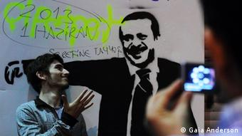 A protester with a picture of Erdogan (photo: Gaia Anderson)