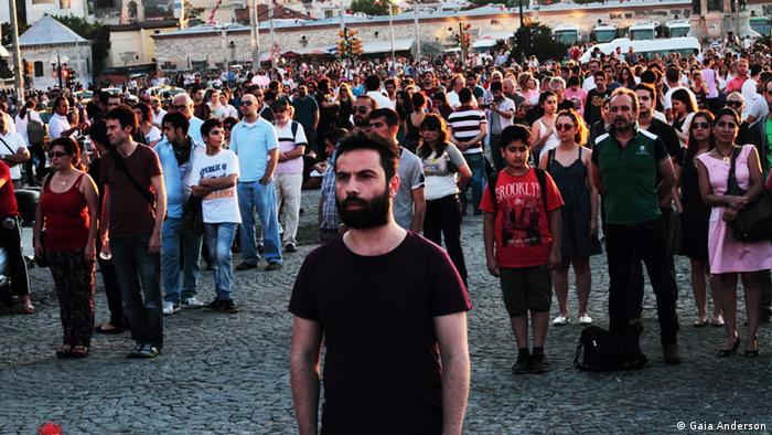 Protesters against Erdogan in Istanbul stand silently for their rights. (Photo: Gaia Anderson)