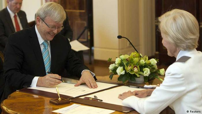 Kevin Rudd (L) signs his commission as Prime Minister of Australia as Governor-General Quentin Bryce looks on at Government House in Canberra June 27, 2013. Kevin Rudd was sworn in as Australian Prime Minister for the second time on Thursday, a day after toppling Julia Gillard and three months out from scheduled elections with polls suggesting the ruling Labor Party is staring at a devastating defeat. Photo:REUTERS/Andrew Taylor