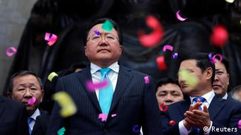 Mongolian President Tsakhia Elbegdorj (C) celebrates his re-election with members of his cabinet at Sukhbaatar square in downtown Ulan Bator June 27, 2013 (Photo: REUTERS/Carlos Barria)