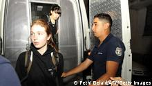 European women of the radical protest group Femen, Josephine Markmann (L) and Pauline Hillier (C) arrive at the Interior Ministry for the final formalities of their release in Tunis, on June 26, 2013. Three European women with the radical protest group Femen were freed from a Tunisian jail June 26th after receiving suspended sentences from an appeal court for baring their breasts in public. AFP PHOTO / FETHI BELAID (Photo credit should read FETHI BELAID/AFP/Getty Images)