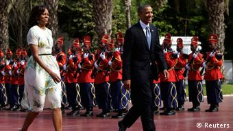 U.S. President Barack Obama and first lady Michelle Obama (L) are greeted by an honor guard at the Presidential Palace June 27, 2013 in Dakar, Sengal. Obama's trip, his second to the continent as president, will take him to Senegal, South Africa and Tanzania. REUTERS/Gary Cameron (SENEGAL - Tags: POLITICS)