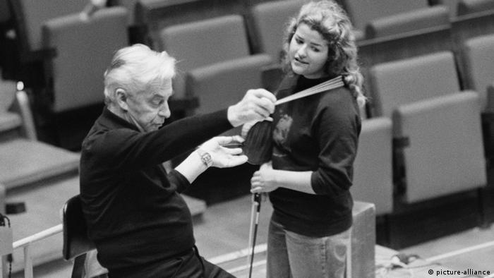 Herbert von Karajan with a young Anne Sophie Mutter in a concert hall
