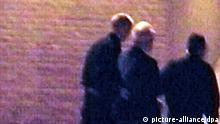 A video-grabbed images showing former Yugoslavian president Slobodan Milosevic (C) being escorted by two prison guards inside the prison yard in The Hague late Thursday, 28 June 2001, after Milosevic was extradited from Yugoslavia to Netherlands. Former Yugoslav president Slobodan Milosevic was handed over to the UN war crimes tribunal in The Hague to face charges on crimes against humanity. The charge sheet of the UN war crimes tribunal in The Hague says that Milosevic planned, instigated, ordered, committed or otherwise aided and abetted in a campaign of terror and violence directed at Kosovo Albanian civilians living in Kosovo in 1999. But a new indictment, likely to be issued in October, would concern the ousted president's role in the 1992-95 war in Bosnia-Hercegovina, the bloodiest and longest conflict in the violent disintegration of the Yugoslav federation. (Bild vom Fernsehschirm, nicht für Zeitschriften, Weiterverkauf, Archive oder Internet!) dpa
